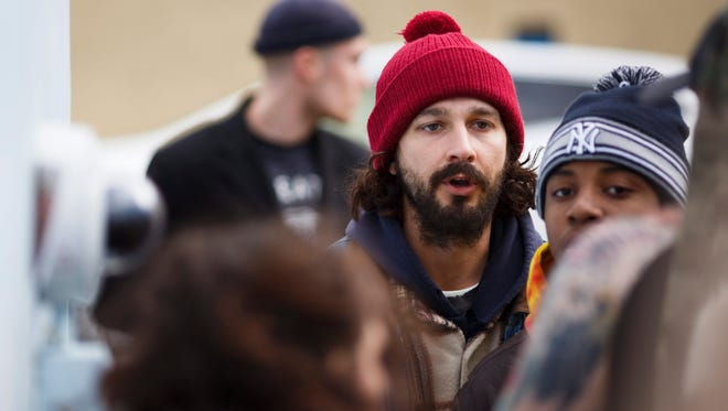 Shia LaBeouf (C) in front of his anti-Trump art installation outside of the Museum of the Moving image in Queens on Jan. 26, 2017.