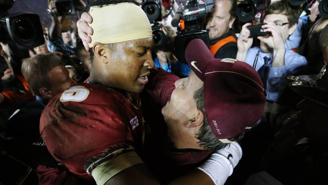Jimbo Fisher (right) and Jameis Winston celebrate winning the BCS National Championship game last season.