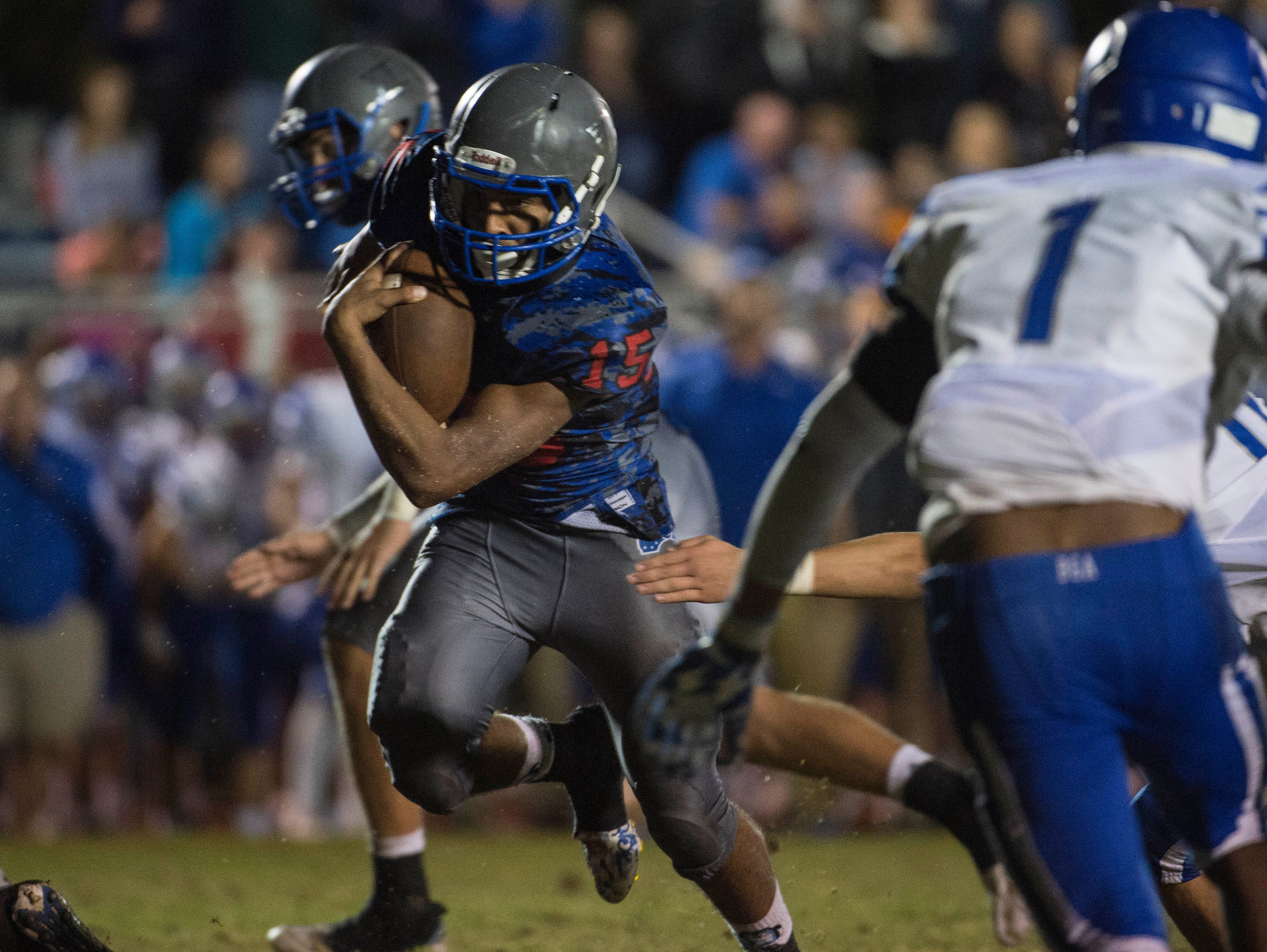 Michael Roberts runs in for a touchdown in overtime at Page High School on Saturday Sept. 26, 2015, in Franklin in Tenn.