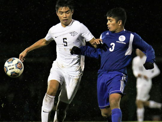 Plymouth's Ryan Wu (left) tries to shield off CC's