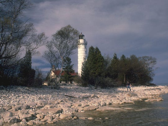The Cana Island Lighthouse, off the shore of Baileys Harbor, is one of the most iconic sights of the annual Door County Lighthouse Festival, this year taking place from June 9 to 11.
