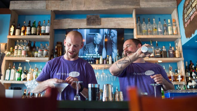 Rob Bagley, right, laughs with fellow bartender Rick Bowers at Michy's Tuesday, May 12 in Rehoboth Beach.