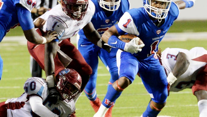 Woodlawn's Brian Byrd tries to get past Minden's defense Friday evening at Independence Stadium during the District 1-4A championship game.