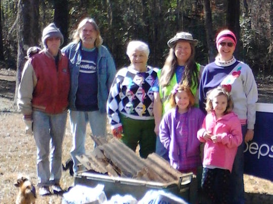 Carol Parker Nunnery, center, is shown in 2014 with small group of Autauga Creek Improvement Committee members gathered at Canoe Trail Park on Reuben Road for the group's winter cleanup of city and county bridges that span Autauga Creek. Nunnery's body was found Tuesday, and her death has been ruled a homicide.