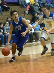 Centerville's Dante Torres dribbles the ball against Lincoln's Darian Bishop during the Wayne County tournament Friday, Jan. 5, 2017 at Hagerstown.