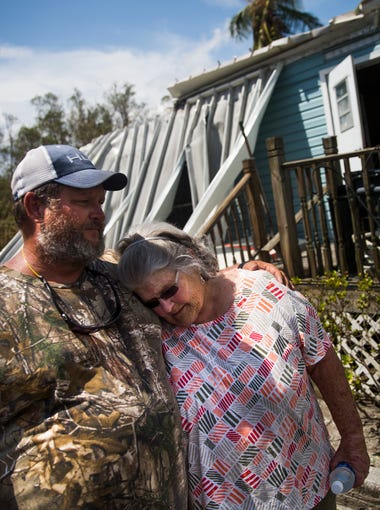 """Robby Daffin consoles his mother, Nancy Daffin, as she returns to her destroyed home on Plantation Island for the first time on Wednesday, September 13, 2017 in Everglades City, three days after Hurricane Irma. """"I care about her more than anything,"""" said Daffin. During the eye of Hurricane Irma, Daffin drove to his mother's house to check on it. While leaving Plantation Island, Daffin became trapped by rapid flood waters and feared for his life. After finally contacting his son on Snapchat, he was rescued from the bridge."""