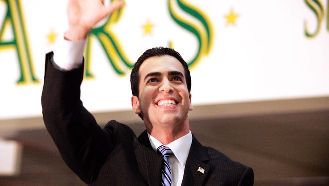 Ruben Kihuen waves to the crowd during his 2011 campaign kickoff celebration at Rancho High School in Las Vegas.