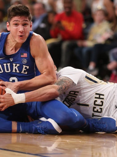Feb. 11: Duke guard Grayson Allen, left, fights for a loose ball against Georgia Tech guard Tadric Jackson during the first half at McCamish Pavilion in Atlanta.