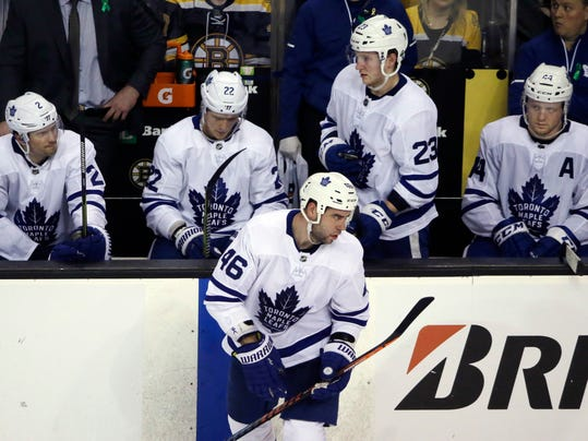 Toronto Maple Leafs' Ron Hainsey (2), Nikita Zaitsev (22), Roman Polak (46), Travis Dermott (23), and Morgan Rielly (44) react during a break late in the third period in Game 1 of the team's NHL hockey first-round playoff series against the Boston Bruins, Thursday, April 12, 2018, in Boston. The Bruins won 5-1. (AP Photo/Elise Amendola)