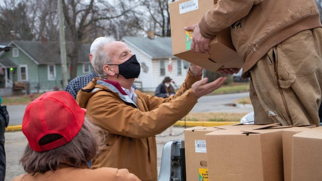 U.S. Sen. Jerry Moran helps distribute boxes of food Tuesday at Oakland United Methodist Church, 801 N.E. Chester Ave. in Topeka.