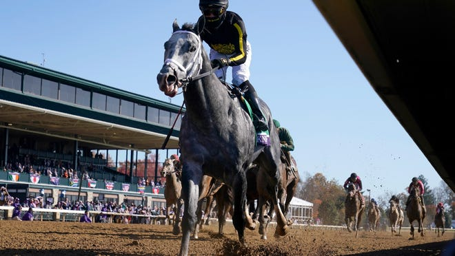 In this file photo, Knicks Go, ridden by Joel Rosario, wins the Breeders' Cup Dirt Mile at Keeneland last November.