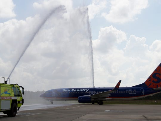 A Sun Country airliner filled with passengers heading to Cancun gets doused by an archway of water provided by the Southwest Florida International Airport Fire Rescue.  It was the inaugural flight to Cancun from RSW.