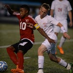 Richmond's Aqib Mohammed works to control the ball against Connersville's Terry Flowers and Jordan Carsey during a sectional soccer game Wednesday, Oct. 7, 2015, on Lyboult Field at Richmond.