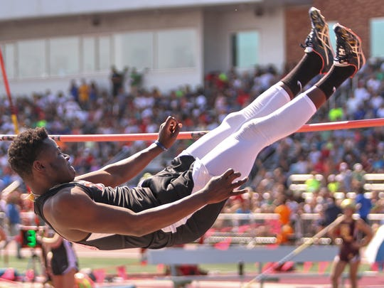 TechÕs Linus Segbe clears 6 feet, 2 inches to take 12th in the Class 2A high jump Saturday, June 10, during state track and field competition at Hamline University in St. Paul..