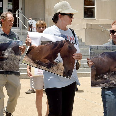Protesters from the Humane Society of Louisiana in