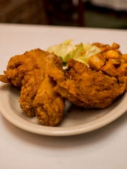 The off-menu fried chicken is served with home fries at La Fonda in Lafayette.