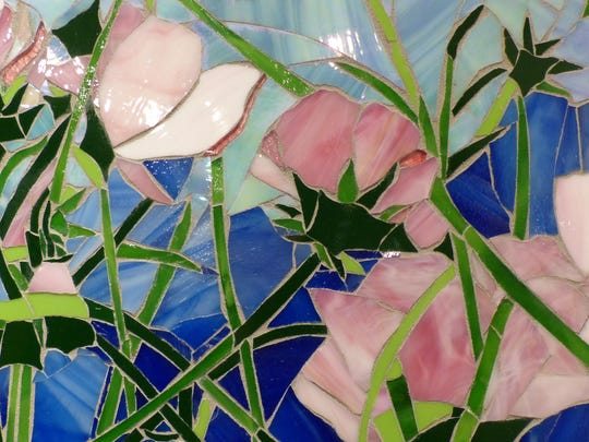 Beautiful pink cosmos are on display in this piece of art.