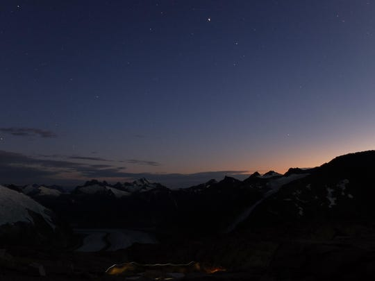 Headlamps swirl in the darkness of the Gilkey Trench in the Juneau Icefield. Donovan Dennis photo