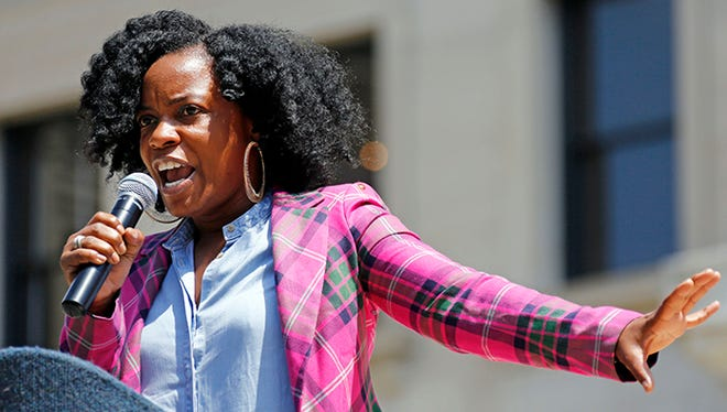 Actress Aunjanue Ellis addresses a rally at the state Capitol in Jackson, Miss., June 29, 2015, calling for the elimination of the Mississippi state flag because of the Confederate flag emblem within it.
