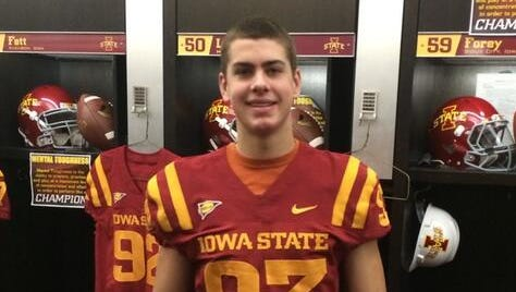 Waukee's Anthony Nelson poses in a Cyclones jersey recently inside the Iowa State locker room.