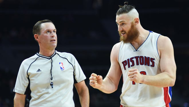 Pistons forward Aron Baynes (12) argues with referee Matt Boland (18) during the third quarter of the Pistons' 102-78 exhibition win Monday at the Palace.