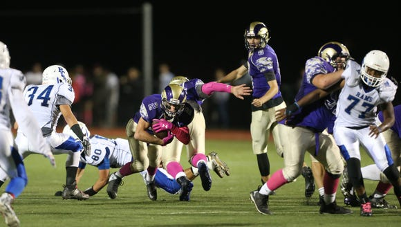 Clarkstown North's Ryan Cox (2) breaks through a hole