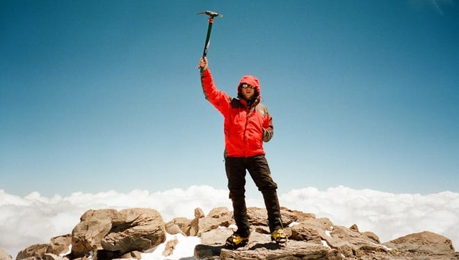 Andy Land of Fond du Lac stands on the summit of Aconcagua in February 2011. It is in the Andes mountain range in Argentina and, at 22,841 feet, is the tallest mountain in the western hemisphere.