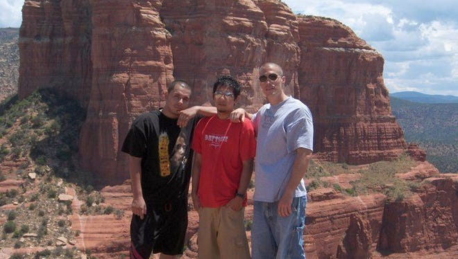 Even after he left teaching, James Foley kept in touch with his students, taking them hiking and pushing them to stay positive. From left to right, Eddie Martinez, Rueben Cruz and Foley.