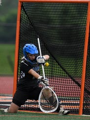 Kennard-Dale goalie Maria Schneider makes a save on a Susquehannock shot on goal during the PIAA Class 2-A girls' lacrosse semifinal, Tuesday, June 5, 2018. John A. Pavoncello photo
