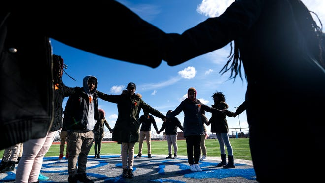 Eastern High School students walk out of class and assemble on their football field for the National School Walkout, a nation-wide protest against gun violence, in Washington, DC.
