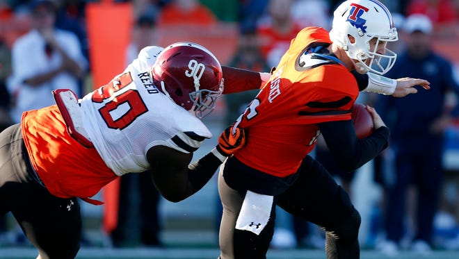 Former Louisiana Tech quarterback Jeff Driskel (16) is tackled during last month's Senior Bowl. Driskel is one of three Bulldogs in this week's NFL Combine.