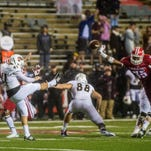 UL Lafayette linebacker Chaiziere Malbrue (35) blocks a punt by ULM punter Chris Qualls (41) during the second half of Saturday's game.