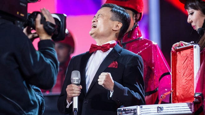 """Jack Ma Yun, chairman of Alibaba Group, reacts during the 2015 Tmall 11.11 Global Shopping Festival gala in Beijing. Shoppers spent nearly 8 billion USD in the first 10 hours of Chinese e-commerce giant Alibaba's """"Singles Day"""" event on Wednesday, the firm said"""