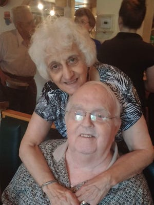 Russell Hawkes, shown with his wife, Rose, had a passion for music, theater and racing.