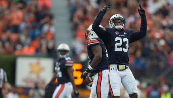 Auburn defensive back Johnathan Ford (23) celebrates