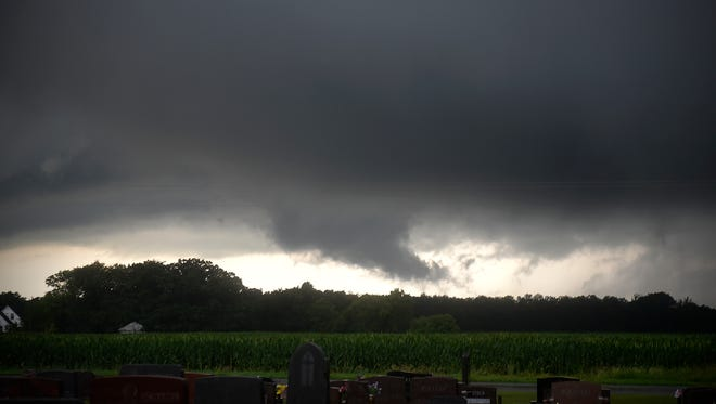 Clouds swirl and drop down from the sky as storms pass through the area north of Luxemburg on Monday, July 11.