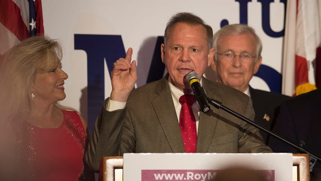 Roy Moore gives his acceptance speech of the Republican Nomination for US Senate during the Roy Moore for Senate election party on Tuesday, Sept. 26, 2017, in Montgomery, Ala.