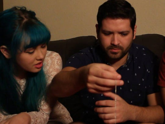 "Rianna Kristine Kirkham (from left), Michael Jay Salinas and Eric Lee Delagarza are shown in a still from the movie ""Muerte: Tales of Horror."" The movie was filmed by Chris Ambriz on cameras, a drone and a GoPro."