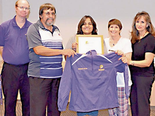 """Submitted Photo   Elizabeth Davila, program manager and advisor at Western New Mexico University-Deming, has been selected as Employee of the Month. Davila was presented with a school jacket by staff at the Mimbres Valley Learning Center. Pictured with Davila are, from left, Phillip Cave, Ken Leupold, WNMU-Deming director; Davila, Margaret Sourcy and Christine Staley. """"Part of our mission is to project a positive image of our university to our internal and external community. To this end, we donated a personalized jacket to Elizabeth in recognition of her outstanding support of the university. The jacket has been purchased with monies donated by the Senate group of 20, whose members are alumni and other friends of WNMU."""