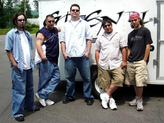 Local James Wamsley, far left, spent 10 years performing in Mansfield band Grendl before moving to Florida to pursue new opportunities. He's now the lead singer of Daybreak Embrace.