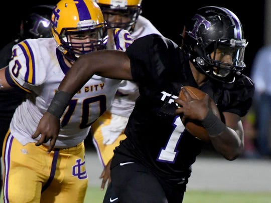 Trinity Christian's Viktor Horton is chased down by Union City's Austin Jernigan during their game Sept. 29, 2017.