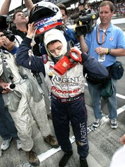 5/30/05 INDY30 #113514 Indianapolis Motor Speedway Photo by Matt Detrich / The Star::: Indy car driver Danica Patrick feels the exhaustion as she takes her gear off before being interviewed on the track after she finished fourth in Sunday's Indianapolis 500.