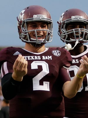 Texas A&M quarterback Johnny Manziel (2) celebrates after throwing a touchdown pass last week.