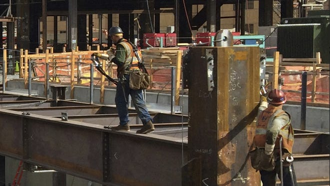 Iron workers erecting the structural steel on the New Stanford Hospital in California.
