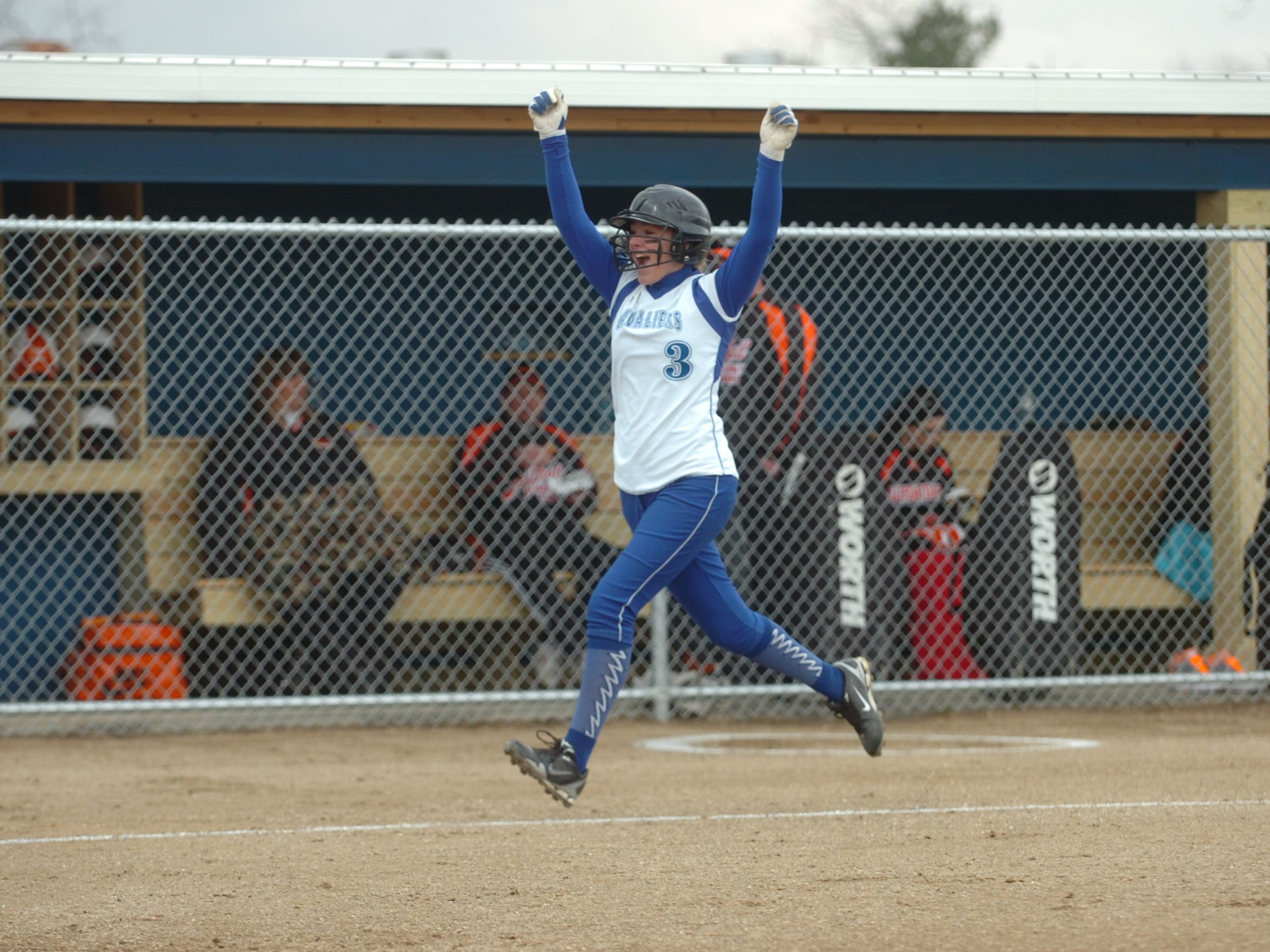 Chillicothe's Marissa Webb celebrates after hitting a home run against Waverly on April 2, 2010. The contest was the Cavaliers' first at Lady Cavalier Field.