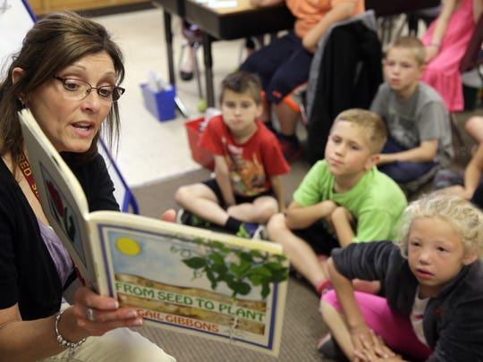 Tammy Charlier leads a reading lesson in her second-grade classroom at Red Smith School.