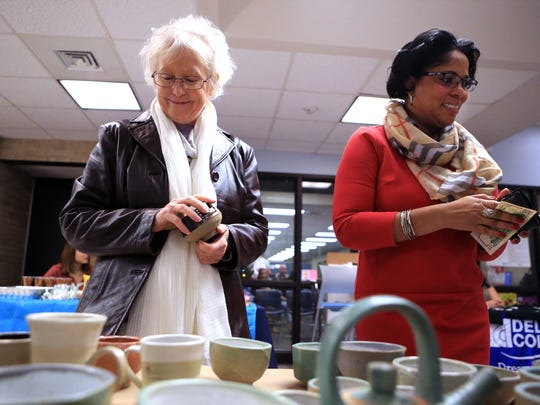 Sally Bickley (left) and Cheryl Sanders shop at the Student Art Association End of Term Ceramic Sale on Monday, Dec. 5, 2016 at Del Mar College.
