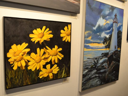 Bailey VanKirk's paintings of local daisies and the Marblehead Lighthouse hang on the walls of Desdemona's Art Gallery.