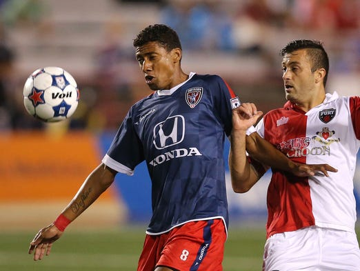 Indy Eleven midfielder Kleberson keeps Ottawa Fury midfielder Sinisa Ubiparipovic off the ball at Carroll Stadium, on Saturday, August 23, 2014, in Indianapolis.