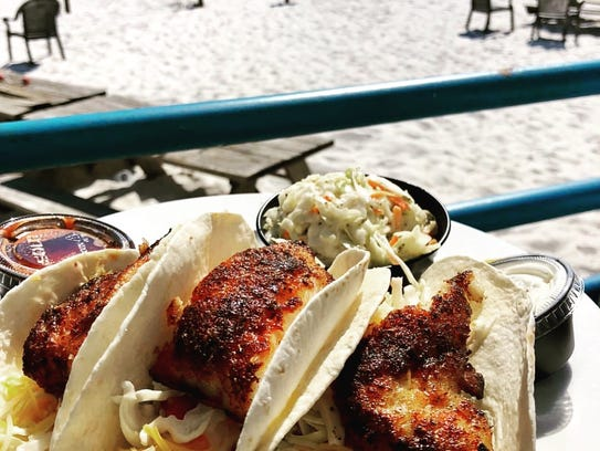 The blackened grouper tacos come with a view at Junkanoo